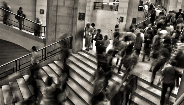 IRC-black-and-white-image-of-people-walking-in-underground